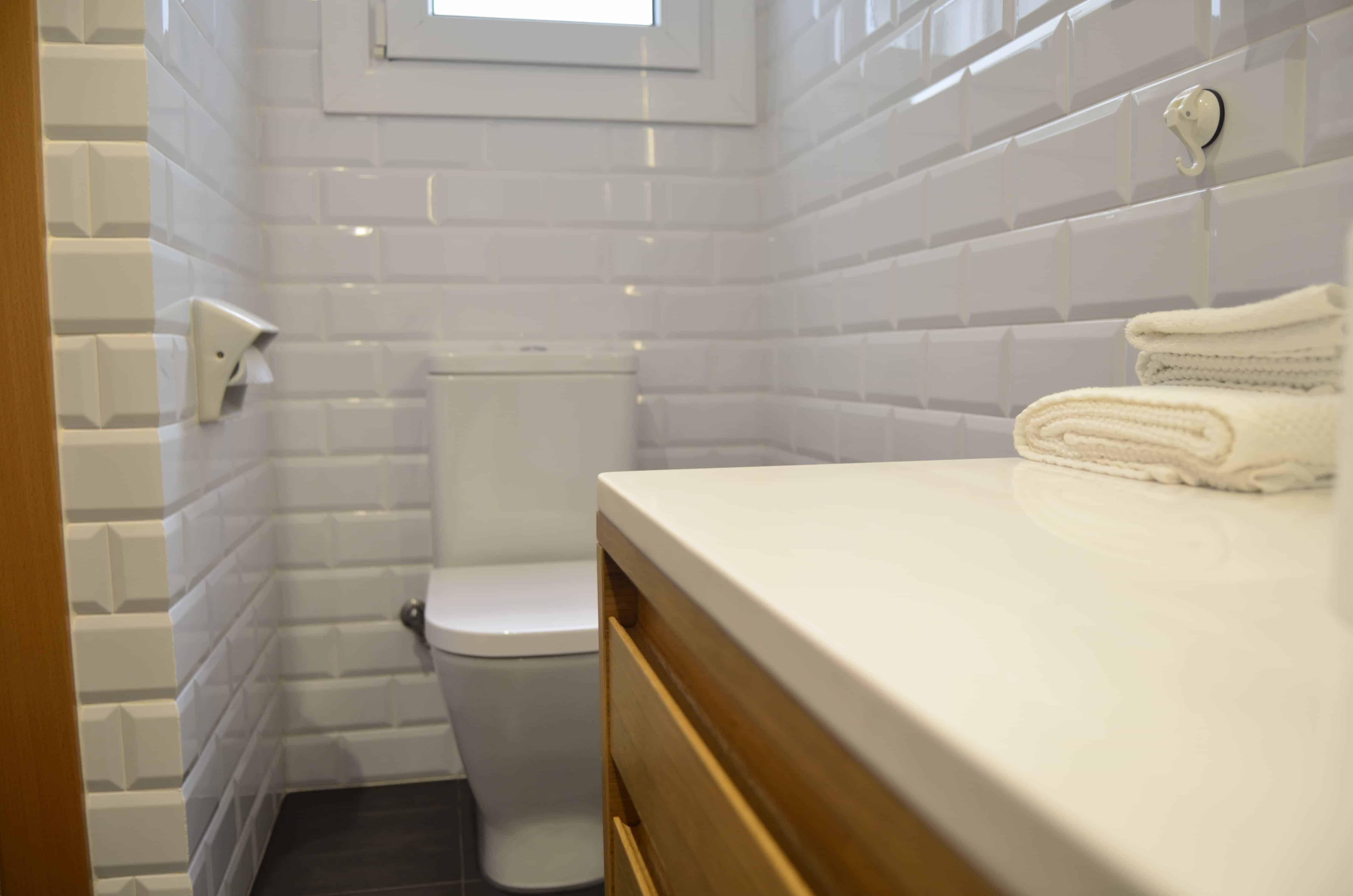baño nuevo después de redistribución contract solutions